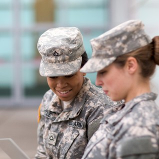 army women looking at tablet